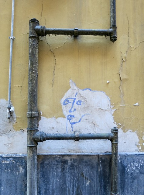 Street art framed by pipes