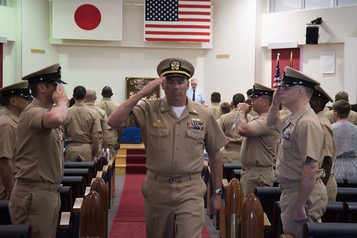 Lt. Cmdr. Michael G. Tyree salutes the sideboys at the conclusion of a change of command ceremony for the Avenger-class mine countermeasures ship USS Chief (MCM 14) .