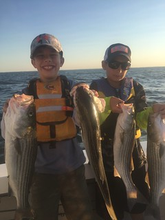 These boys are all smiles with their nice catch of striped bass.