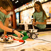 Members of the Quadrumaniacs First Lego League team working on their robots