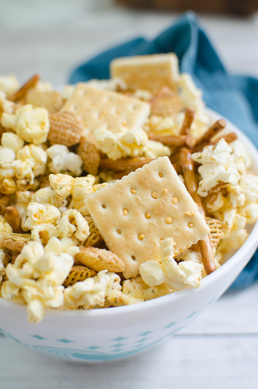 Dill Pickle Popcorn Mix - popcorn, pretzels, cereal, and crackers that tastes just like pickles! The perfect snack mix for movie nights or lunchboxes!