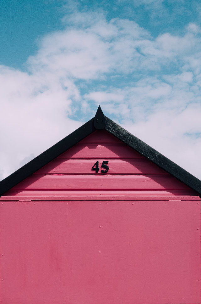 pink beach hut in hamworthy