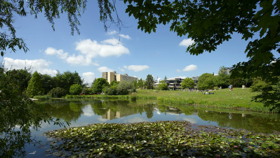 A view of the University of Bath across the lake