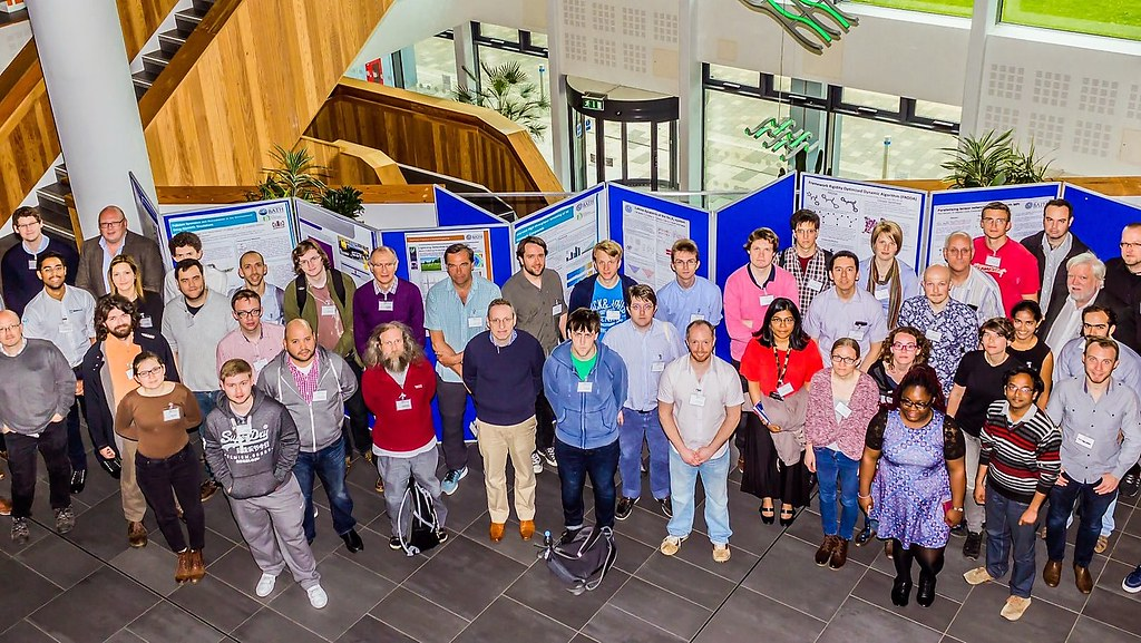 Participants gathered next to posters for the HPC 2017 symposium