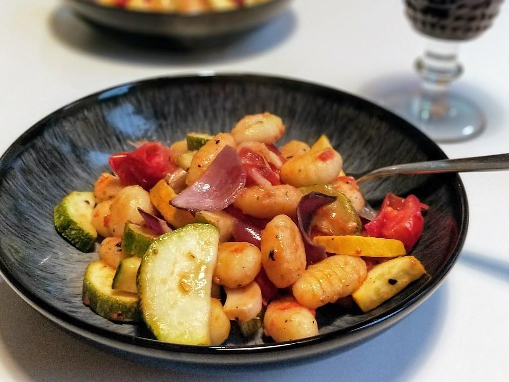 Courgette, tomato and gnocchi bake in bowl