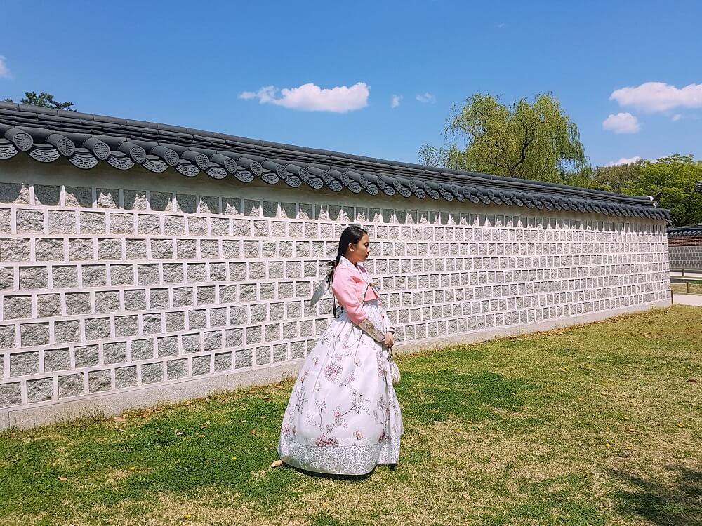 wearing traditional korean clothes