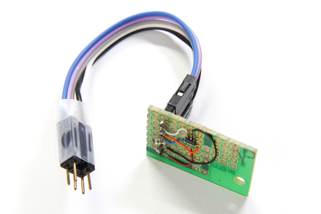 ATtiny10 board with attached AVR ISP programming connector