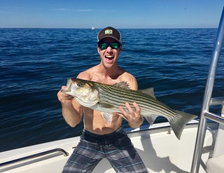Eric Zegowitz is very happy with this nice striped bass he caught