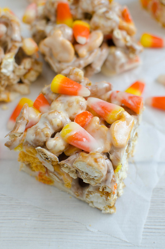 Caramel Corn Treats are the perfect sweet and salty fall snack! Caramel corn, pretzels, cheddar Goldfish, and candy corn all coated in melted marshmallow! You won't be able to stop snacking on these!