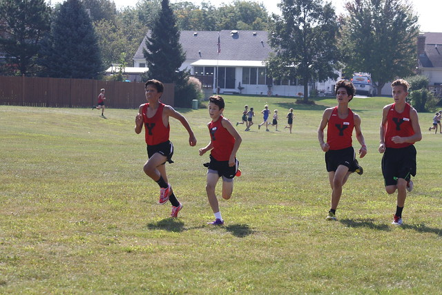 Nicholas Clever, Jaydon Harvey, Nick Sinopoli, and Owen Lindstrand form a great pack at the Tiger Trails Invite in Oswego