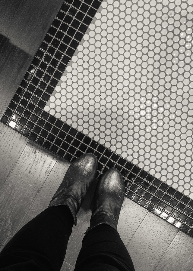 silver boots on tiled floor at kiehl's cardiff