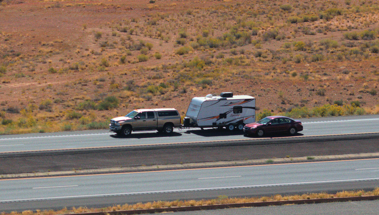 "A Sportster travel trailer on I70 about 35 miles west of Green River, Utah. (38°51'49.0""N 110°48'51.0""W)"