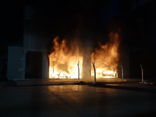 The fully engulfed cross-laminated building during test one