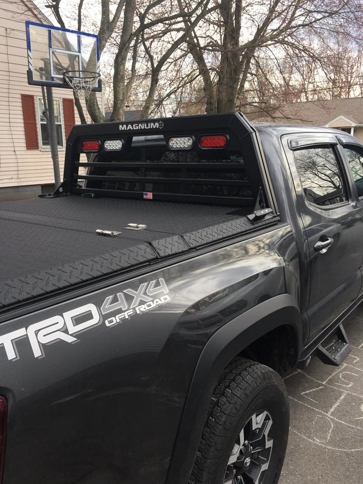 An Aluminum Truck Bed Cover On A Toyota Tacoma A