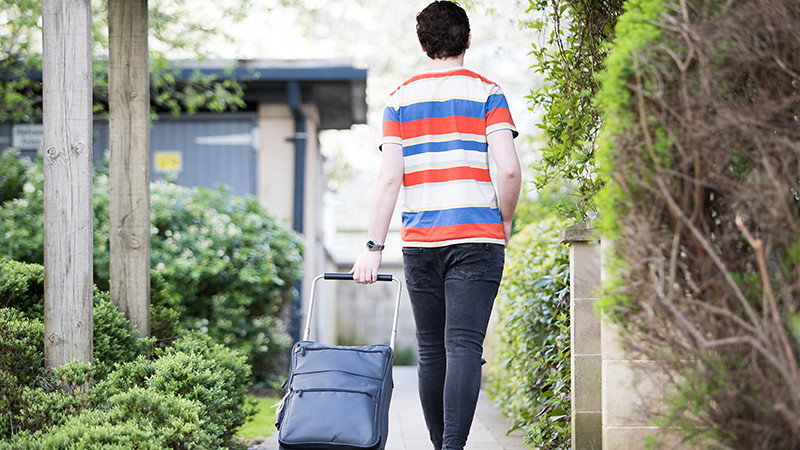 A student moving into John Wood Court in the city of Bath