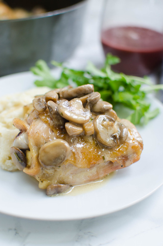 Chicken Thighs with Creamy Rosemary Mushrooms - crispy chicken thighs topped with mushrooms in a creamy sauce! Low carb, delicious, and ready in about 30 minutes!