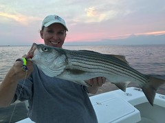 Nora Long, with a nice striped bass caught on a jig