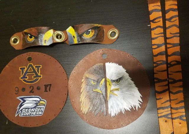 Brown leather lure and jesses with images of eagles and the game date of September 2, 2017