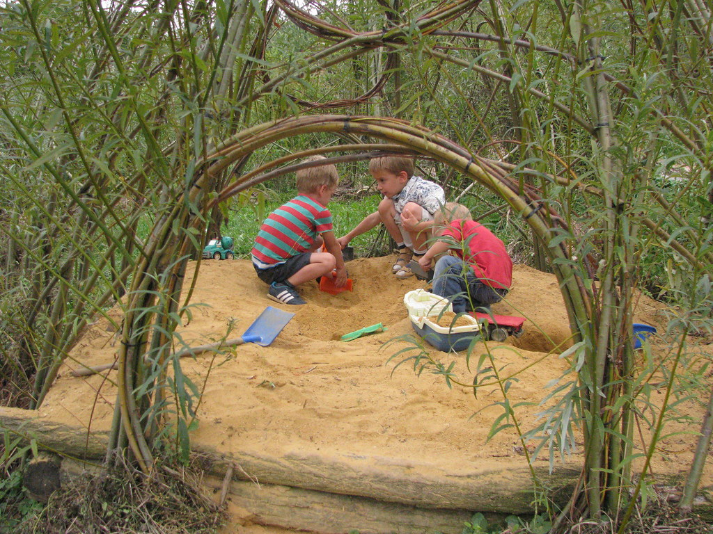 Children play in the sandpit