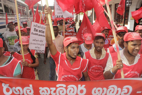 Protesters with FTZ GSEU in Sri Lanka wearing red carry signs and rally on May Day 2017