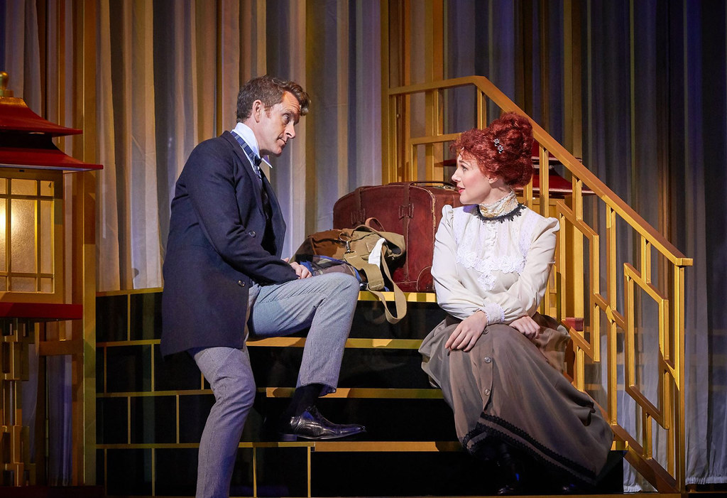 The mobile set cleverly created corners and dimensions to the show -- Carl and Kate on the staircase | Photo Credits: Singapore Repertory Theatre
