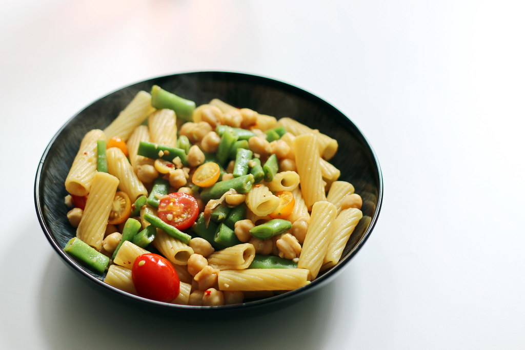 Green bean pasta with ponzu sauce in bowl