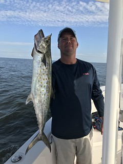 Travis Long holds up a nice Spanish mackerel