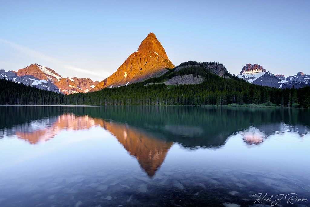 mount grinnell takes on a warm glow from the light of a ri flickr