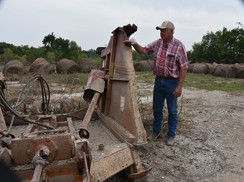 Liberty County rancher Jack Carraway showing the high water mark left on farm equipment