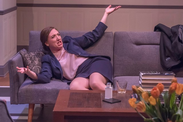 """A female cast member is dramatically sitting on the couch during Auburn University's Department of Theatre's production of """"God of Carnage."""""""