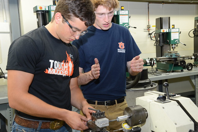 Engineering students are seen working in the Design and Manufacturing Laboratory.