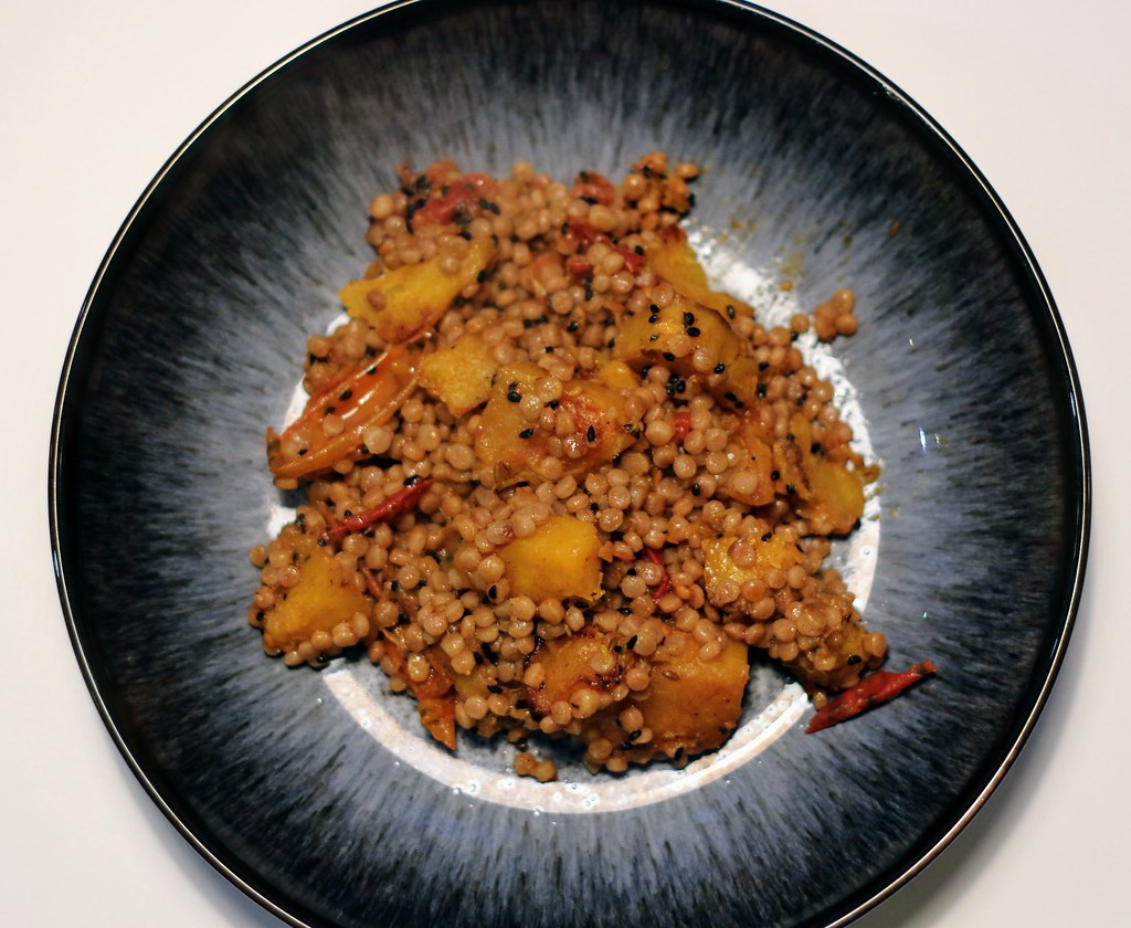 Roast squash and tomato couscous seen from above in bowl