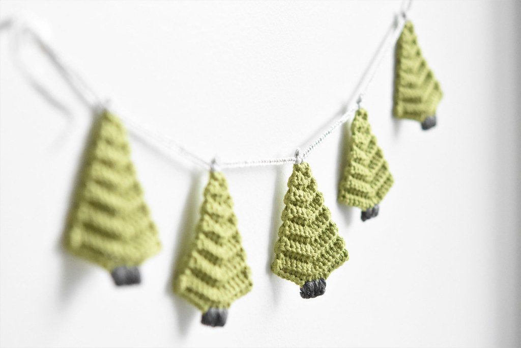 Gold and white paper punched tree garland by courtney cerruti