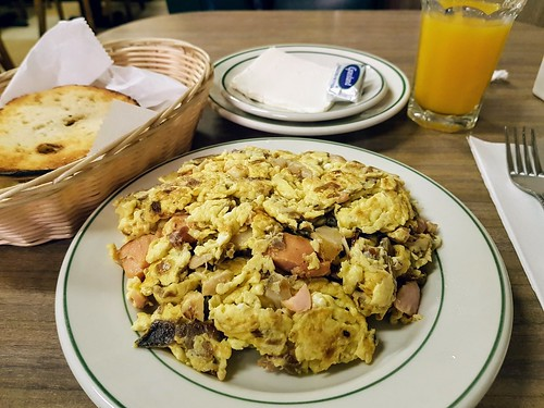 Combination of Sturgeon and Nova Scotia Salmon  Scrambled with Eggs & Onions