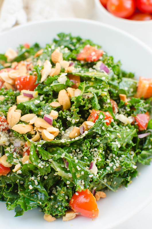 Paleo Pesto Kale Salad - delicious kale salad with lots of veggies and a paleo (and vegan!) pesto. Prep ahead for lunches and top with an egg or roasted chicken for a complete meal!
