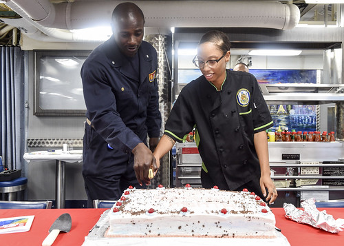 WATERS NEAR GUAM (NNS) -- Sailors aboard the Arleigh Burke-class guided-missile destroyer USS Benfold (DDG 65) celebrated National Hispanic Heritage Month with an event hosted by the ship's multicultural committee, Oct. 4.