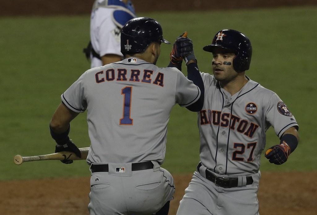 Carlos Correa(圖左)與Jose Altuve合力包辦7分打點。(達志影像資料照)