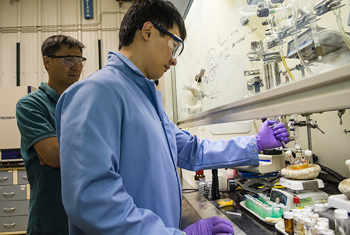 Jaehoon Lim works on an apparatus that synthesizes quantum dots along with Los Alamos researcher Young-Shin Park