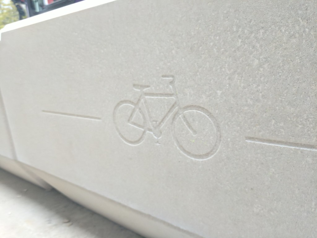 ... Check Out That Logo On The Concrete Planters Lining The Protected Bike  Lane On Pike St