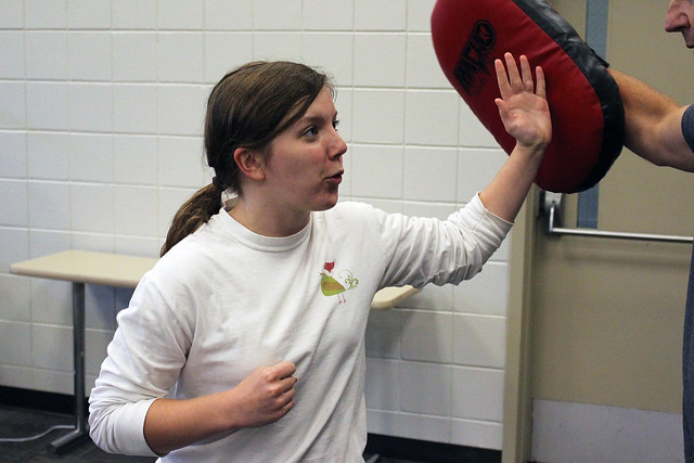 Madison Atwater strikes an arm pad during technique training.