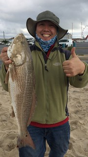 Photo of angler Song Lee with a Red Drum