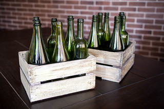 Two boxes of green wine bottles | by wuestenigel