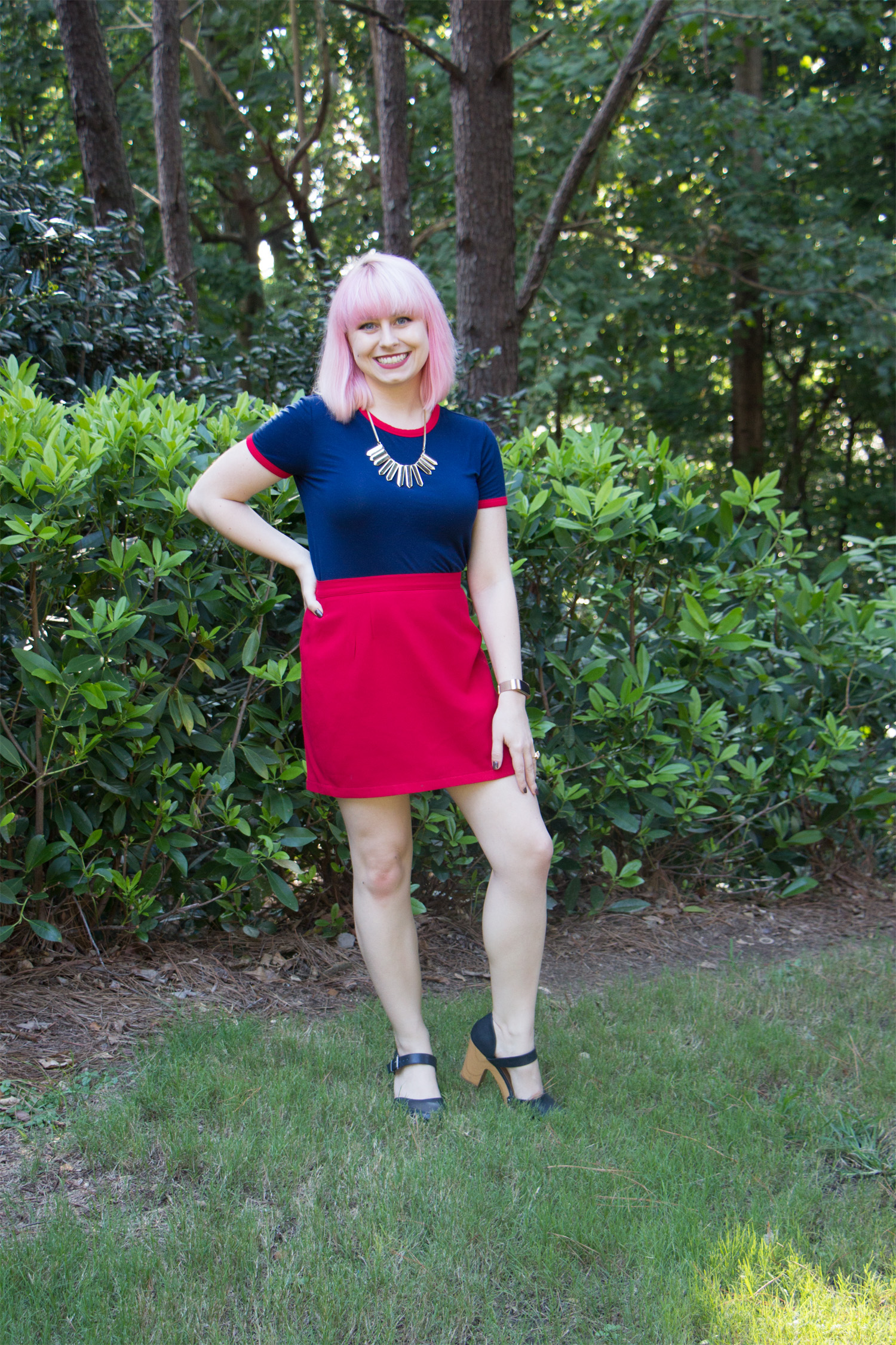 Navy Blue and Red Outfit. Wearing Blue Clogs and a Red Mini Skirt