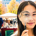 Girl Magnifying Glass Asian Chinese Flea Market Outdoors Falls S