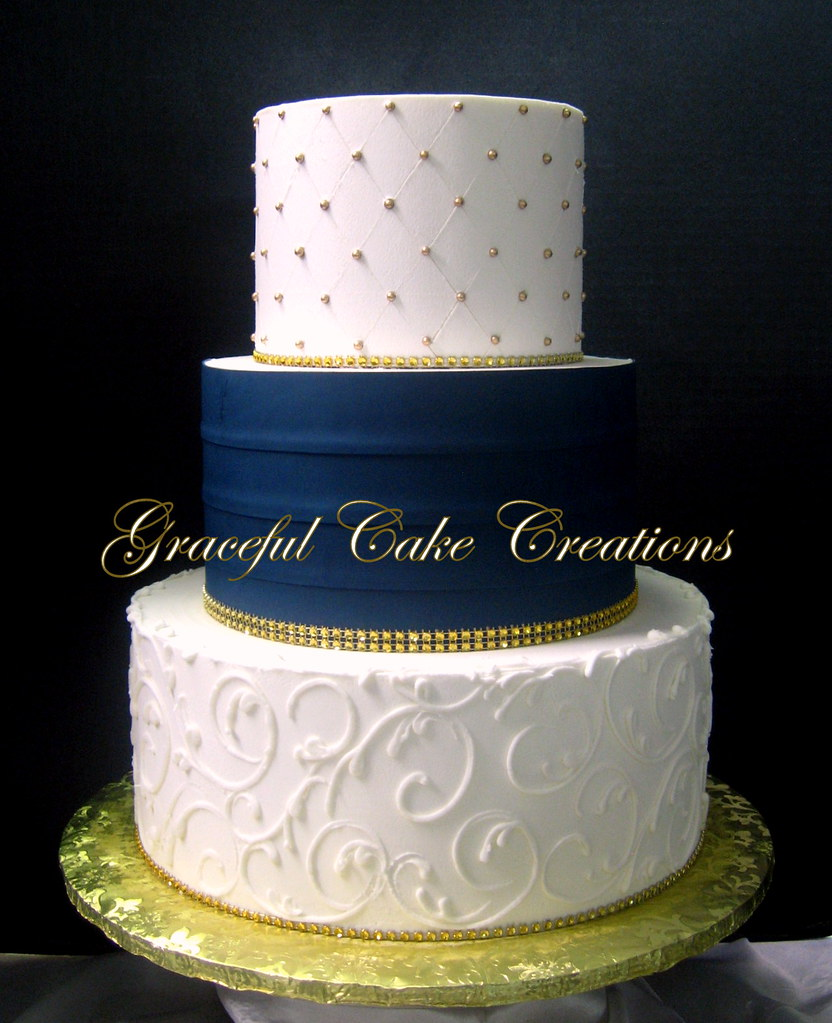 wedding cake ideas navy blue ivory butter wedding cake with a navy blue s 22926
