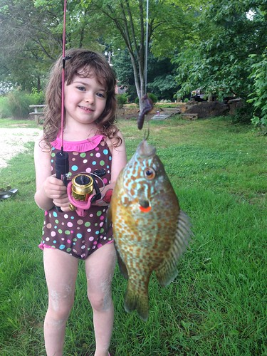 Little girl with a redear sunfish