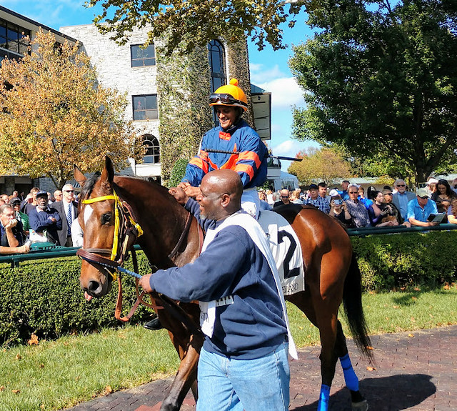 Jockey Anthony Stephen and groom Jerry Dixon are shown with War Eagle's Love in the Keeneland paddock.