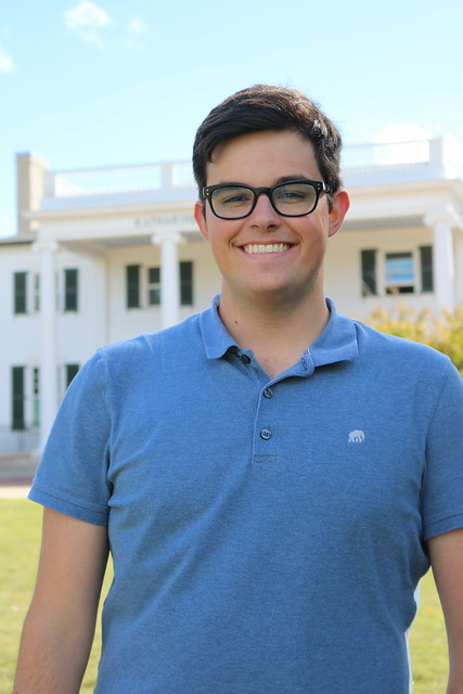 Headshot of senior Matthew Rogers in front of Cater Hall.