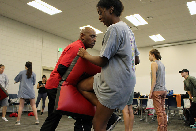 Kyra Callens practices knee strikes with instructor Keith Walton.