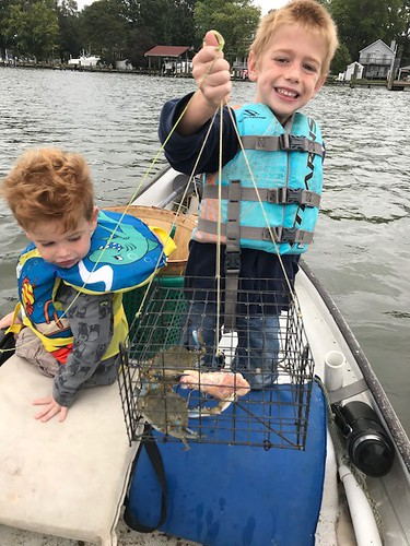 Two young boys crabbing